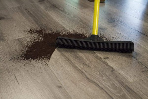rubber broom cleaning tile